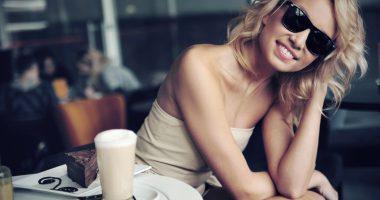 Cute blond beauty wearing sunglasses